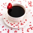 White cup of coffee decorated with red heart — Stock Photo