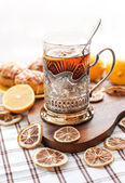 Black tea with lemon in the silver glass-holder — Stock Photo