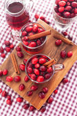 Mulled wine with cranberry and spices — Stock Photo