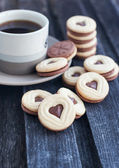 Cup of coffee and heart shaped cut out cookies — Stok fotoğraf