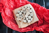 Gift decorated with wooden heart — Stock Photo