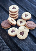 Heart shaped cut out cookies with chocolate filling — Stock Photo
