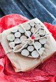 Gift decorated with wooden heart — Стоковое фото