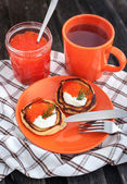 Pancakes with red caviar and sour cream — Stock Photo
