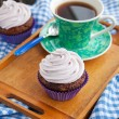 Cupcake and cup of coffee — Stock Photo #40596747
