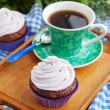 Cupcake and cup of coffee — Stock Photo #40596757