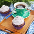 Cupcake and cup of coffee — Stock Photo