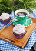 Cupcake and cup of coffee — Stockfoto