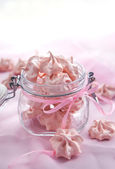 Pink meringues in a glass jar — Stock Photo