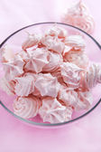 Pink meringues in a glass bowl — Stock Photo