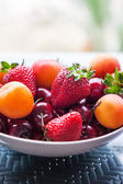 Assorted colorful fresh summer berries and fruits — Stock Photo
