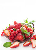Fresh strawberry and redcurrant on white — Stock Photo