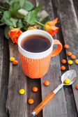 Cup of tea and colorful candies — Stock Photo