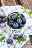Fresh blueberry in the mug — Stok fotoğraf