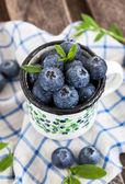 Fresh blueberry in the mug — Stock Photo