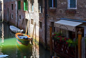 Venice channel with boats — Stock Photo