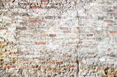 Natural scratched brick background — Stock Photo