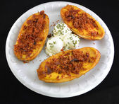 Potato skins with cheddar cheese and bacon — Stock Photo
