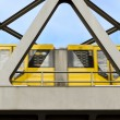 Yellow moving tram on a bridge in berlin — Stock Photo #24911121