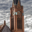 Closeup of red brick steeple with dramatic sky — Zdjęcie stockowe #24911151