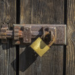 Stock Photo: Old key lock on wooden door