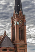 Closeup of a red brick steeple with dramatic sky — Stock Photo