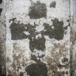 Faded cross  on an old parget wall — Stock Photo