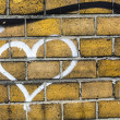 Stock Photo: Heart graffiti on brickwall