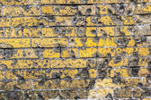 Old brick wall pattern closeup with bullet holes from WW2 — Foto de Stock