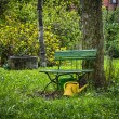 Garden bench with yellow ewer — Stock Photo