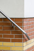 Detail of an hand rail on a brick-wall — Stock Photo
