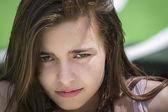 Closeup portrait of a sad, angry teenage girl — Stock Photo