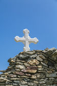Orthodox cross at an ancient wall — Stock Photo