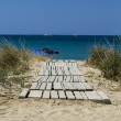 Wooden way, leading to the ocean at beach — Stock Photo