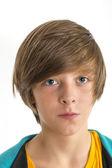 Teen boy smirking into the camera, isolated on white — Stock Photo