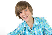 School boy is laughing into the camera, isolated on white — Stock Photo