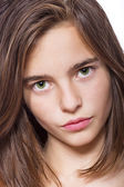 Closeup portrait of a teenage girl isolated on white — Stock Photo