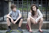 Two dirty urban teens sitting on a wall — Stok fotoğraf