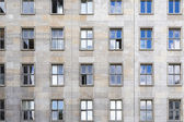 Old facade with sky mirroring in the windows — Stock Photo