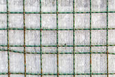 Metal grid with metallic surface in background — Stock Photo
