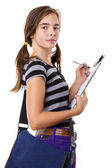 Teenage girl writing on a clipboard, isolated on white — Stock Photo