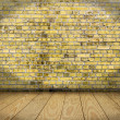 Indoor background with yellow brick wall and wooden plank floor — Stock Photo