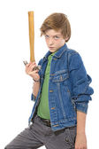Confident teenage boy holding the head of a hammer in one hand, — Stock Photo
