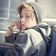 Stock Photo: Portrait of teenager boy with toque, sitting in bus