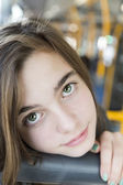 Portrait of a beautiful teenager girl, sitting in a bus — Photo