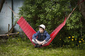 Cool teenager boy having a break in a hammock — Foto de Stock