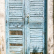 Very old blue grungy greek door in summer — Zdjęcie stockowe