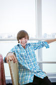 Laughing male teenager going with a ferry — Stock Photo