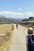 Two teenager walking on a street in mediterranean landscape — Stock Photo