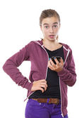 Surprised female teenager with smart phone in one hand, isolated — Stock Photo